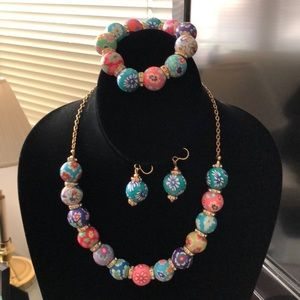 One of a kind set, colorful clay beads/gold tone.